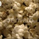 Popcorn Tossed Up In The Air Against Black Background An Overhead Shot 4K - VideoHive Item for Sale