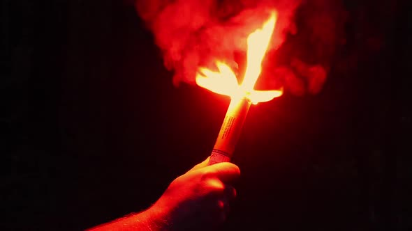 Burning Red Flare Held Up At Night by RockfordMedia | VideoHive