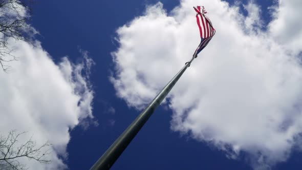 American Flag with Clouds Moving in the Background