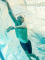 76 year old swimmer, underwater view