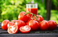 Tomatoes and juice in the garden. Organic food - PhotoDune Item for Sale