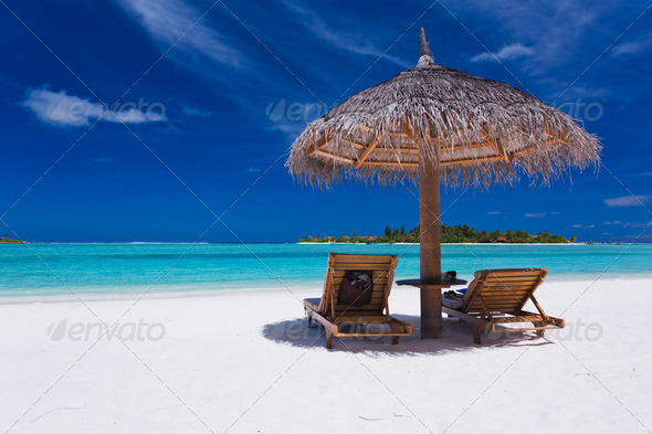 Two chairs and umbrella on stunning beach - Stock Photo - Images