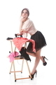 Contemplating Attractive Woman Ironing Clothes Over White Background - PhotoDune Item for Sale