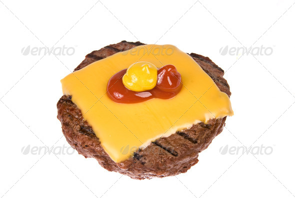 Hamburger patty with cheese, mustard and ketchup - Stock Photo - Images