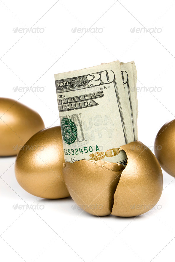 Hatched golden egg and cash - Stock Photo - Images