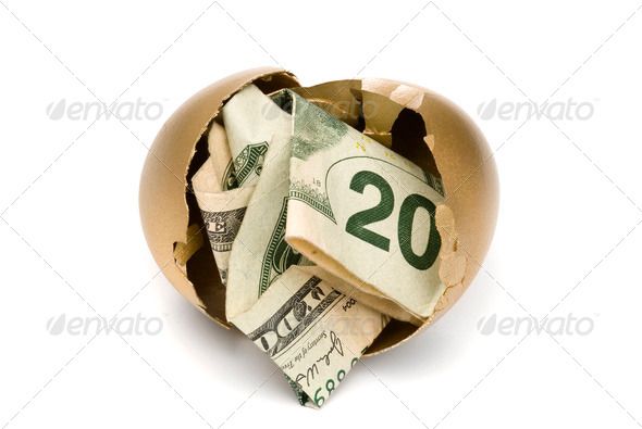 Hatched golden egg with cash - Stock Photo - Images