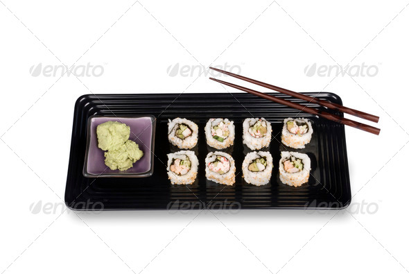 Sushi rolls on plate with chopsticks - Stock Photo - Images