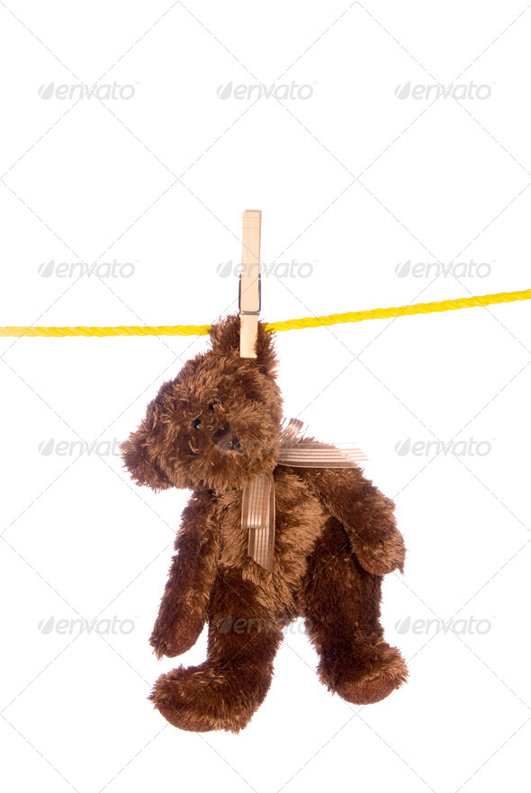 Teddy bear hanging from a clothesline - Stock Photo - Images