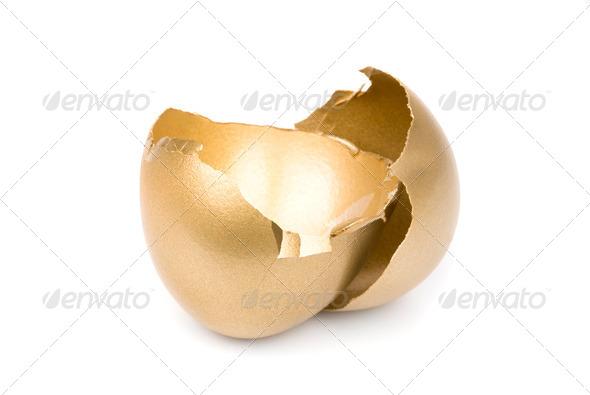 Broken golden egg - Stock Photo - Images