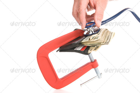 Clamped wallet examined with stethoscope - Stock Photo - Images