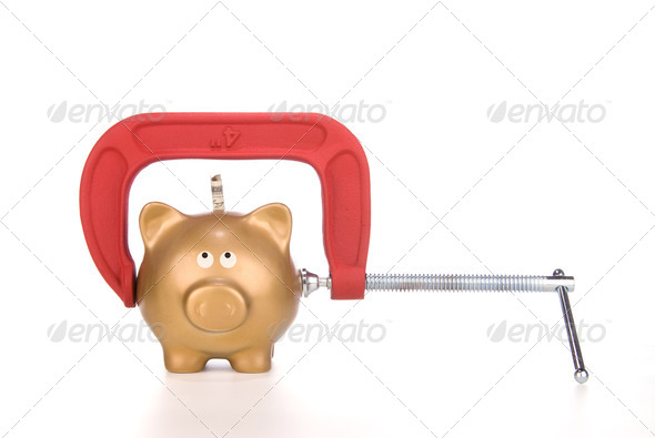 Piggy bank being squeezed - Stock Photo - Images