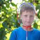 Boy Looking Through Tennis Racket - VideoHive Item for Sale
