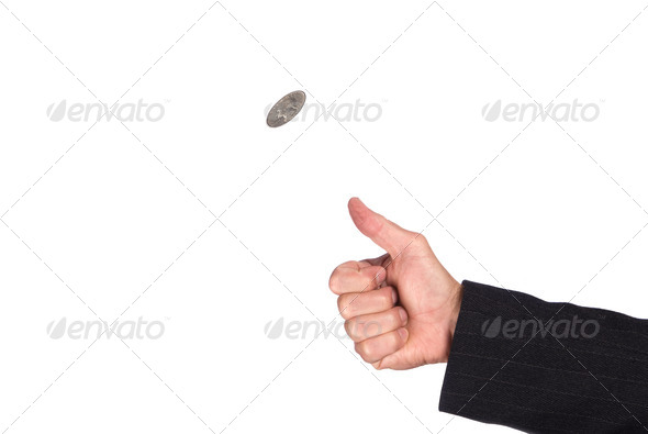 Flipping coin - Stock Photo - Images