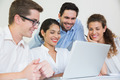Group of smiling business people working on laptop together in office - PhotoDune Item for Sale