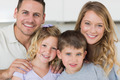 Closeup portrait of family smiling together in house - PhotoDune Item for Sale