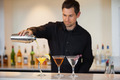 Bartender pouring cocktails at the bar - PhotoDune Item for Sale
