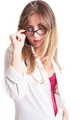 Portrait Of Young Female Doctor Peering From Eye Glasses Over White Background - PhotoDune Item for Sale