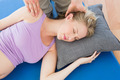 Pregnant woman having a relaxing massage in a studio - PhotoDune Item for Sale