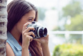 Pretty girl taking photographs outside on a sunny day - PhotoDune Item for Sale