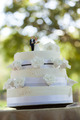 Close-up of figurine couple on wedding cake at the park