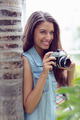 Stylish young girl taking photographs outside on a sunny day - PhotoDune Item for Sale
