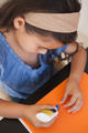 High angle close-up of a young girl doing craftwork at home - PhotoDune Item for Sale
