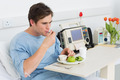 Young man having healthy food on hospital bed - PhotoDune Item for Sale