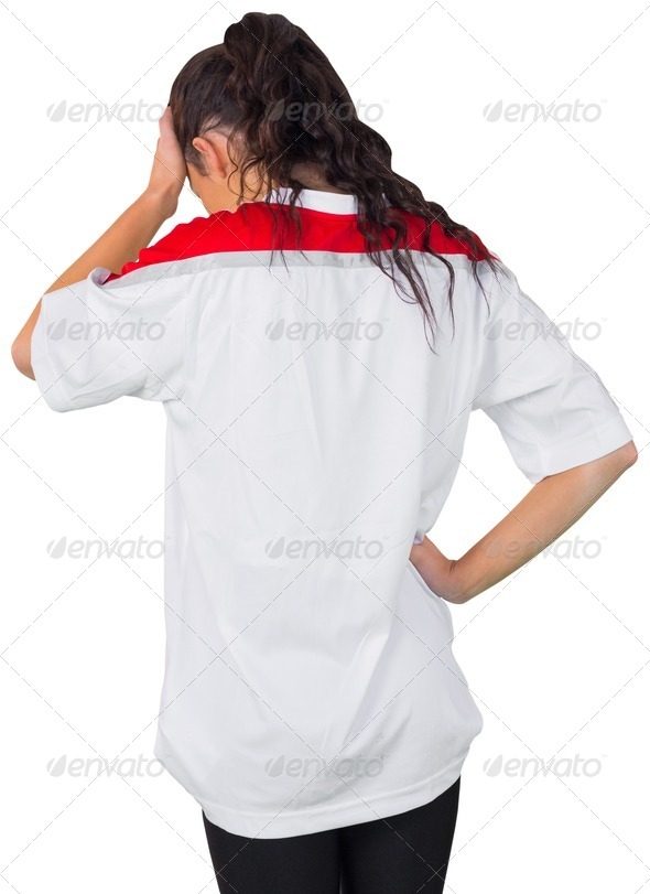 Disappointed football fan in white on white background - Stock Photo - Images