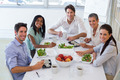 Workers smile at camera while eating healthy lunch in the office - PhotoDune Item for Sale