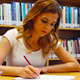 College Student is Studying in Library - VideoHive Item for Sale