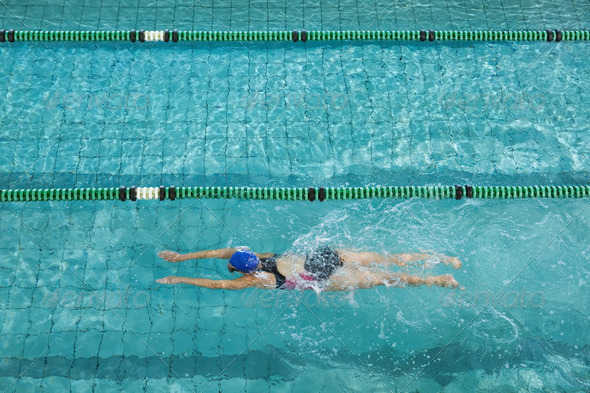 Female swimmer training by herself in swimming pool at the leisure centre - Stock Photo - Images