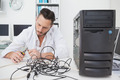 Computer engineer working on broken cables in his office