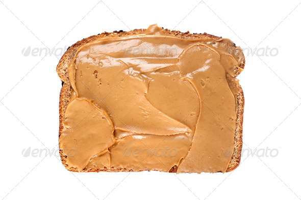 Slice of bread with peanut butter - Stock Photo - Images