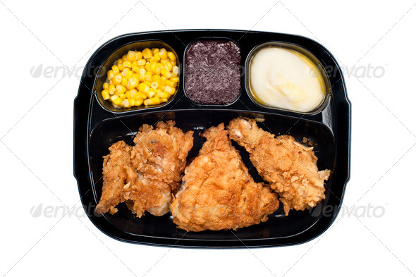Chicken TV dinner in plastic tray - Stock Photo - Images