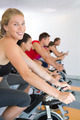 Blonde smiling at camera during spin class at the gym - PhotoDune Item for Sale