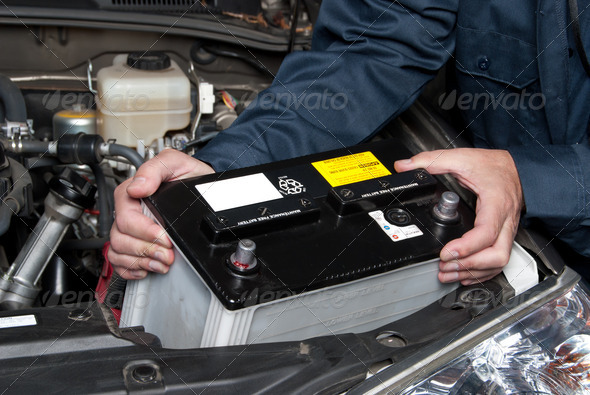 Auto mechanic replacing car battery - Stock Photo - Images