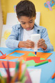 Cute little boy making art in classroom at the nursery school - PhotoDune Item for Sale