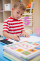 Cute little boy drawing at desk at the nursery school - PhotoDune Item for Sale
