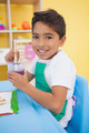 Cute little boy painting at table in classroom at the nursery school - PhotoDune Item for Sale