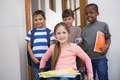 Disabled pupil with his friends in classroom at the elementary school - PhotoDune Item for Sale