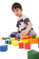 Happy little boy playing with building blocks on white background - PhotoDune Item for Sale