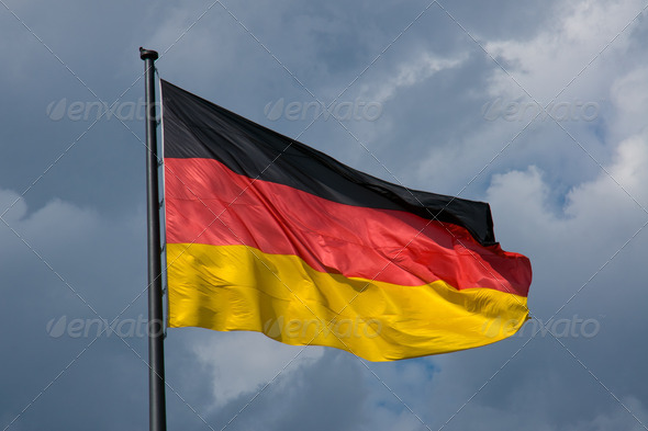 German flag in front of dark clouds - Stock Photo - Images