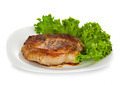 meat steak with lettuce isolated on white background