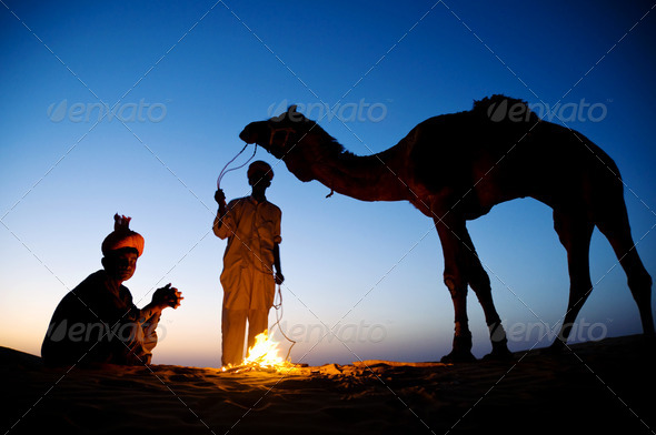 Two Indigenous Indian Men Resting By The Bon Fire With Their Cam - Stock Photo - Images