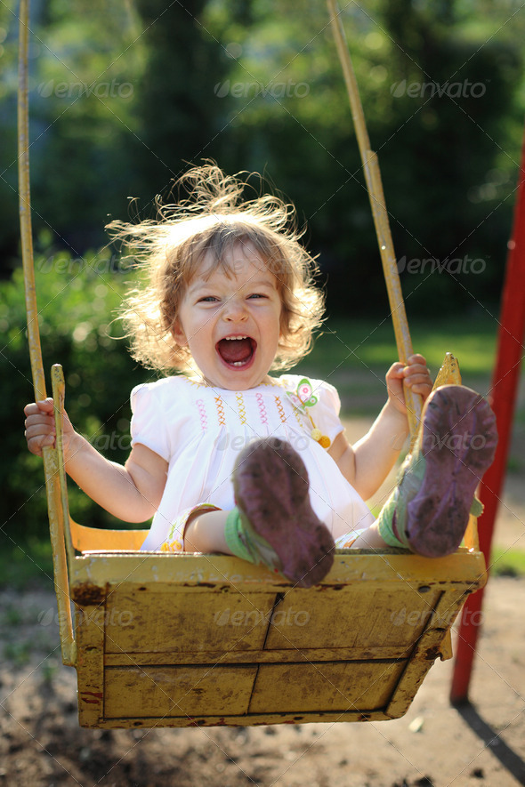Child on swing - Stock Photo - Images