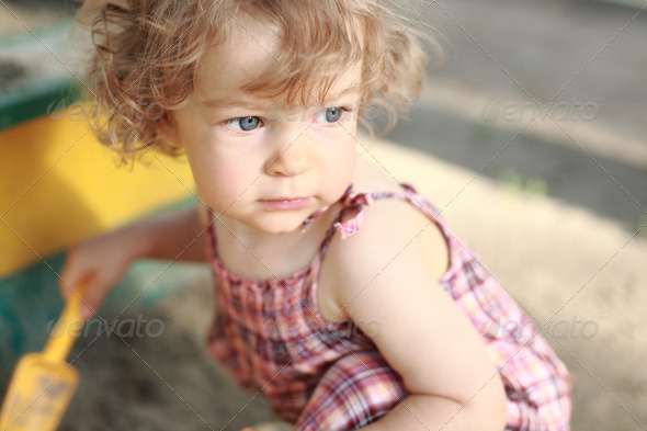 Child in sandpit - Stock Photo - Images
