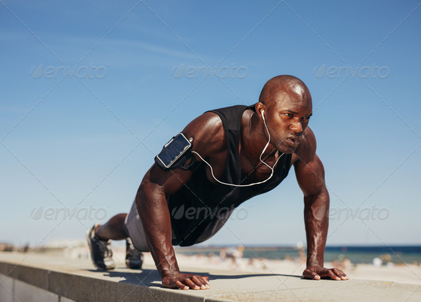 Young athletic man doing push-ups - Stock Photo - Images