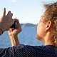 Girl Taking Photo of Island by Smart Phone - VideoHive Item for Sale