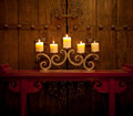 Candles burning on table in front of old rustic door - PhotoDune Item for Sale