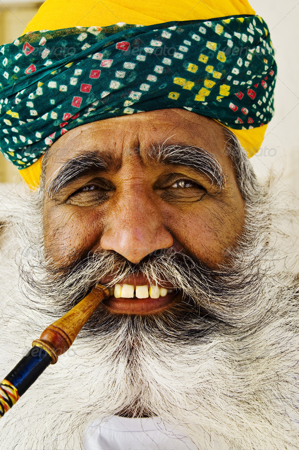 India Man Smoking a Pipe - Stock Photo - Images